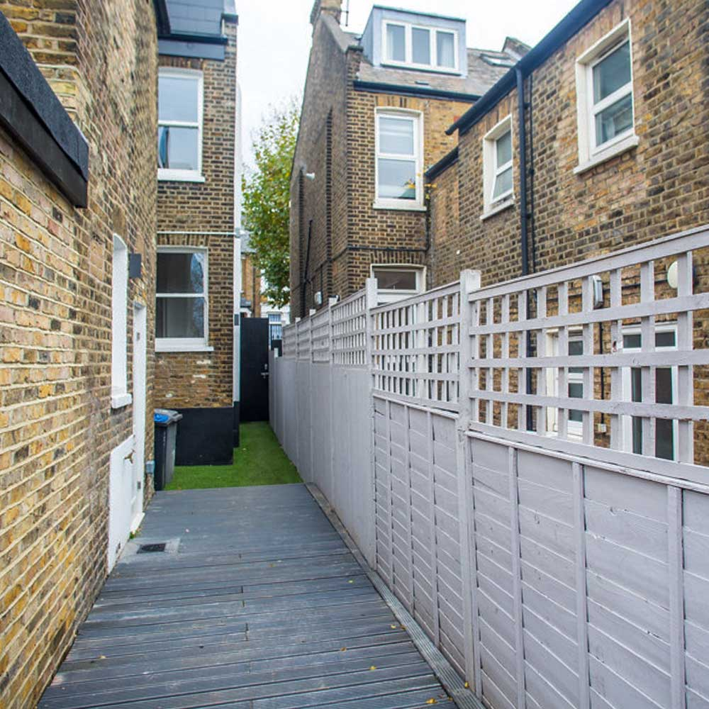 A walkway to the garden in a housing conversion in Brent