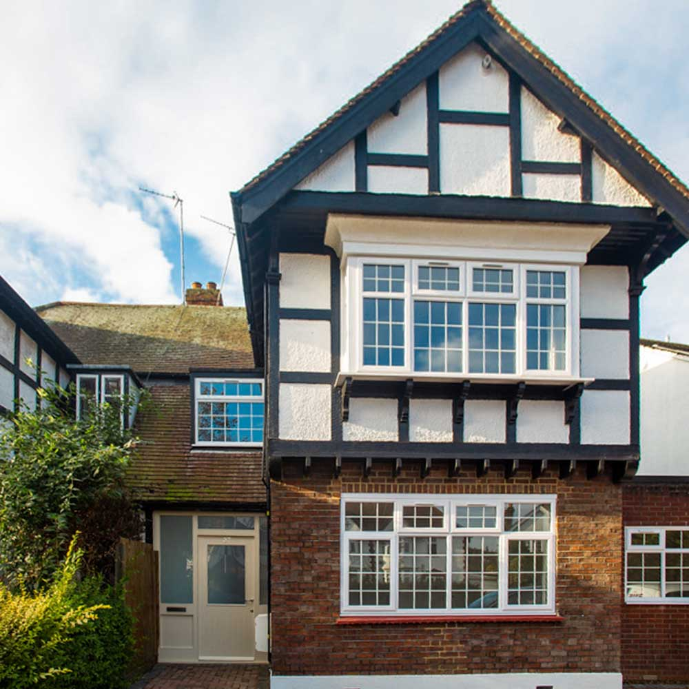 front of a house conversion in Brentwood showing the windows and drive on a sunny day