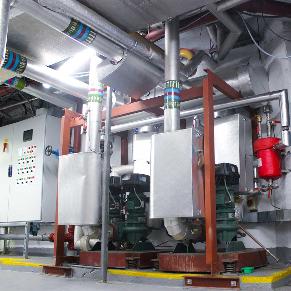 Commercial-boiler-installation-pipes-and-control-box-and-valves-in-basement