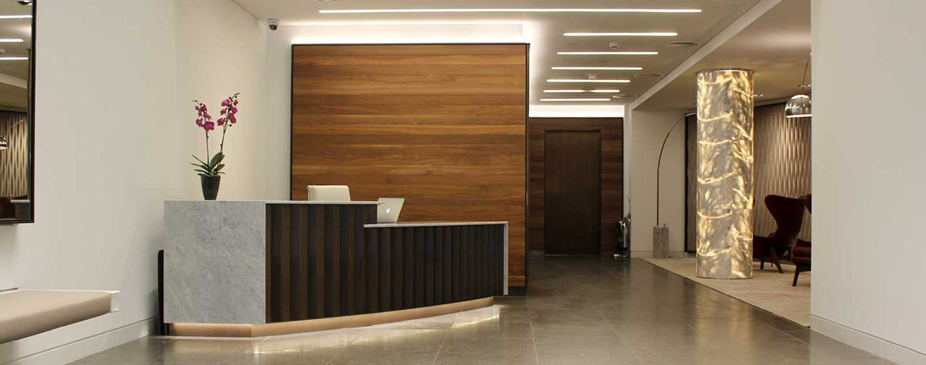 desk chairs and walls in a reception space.