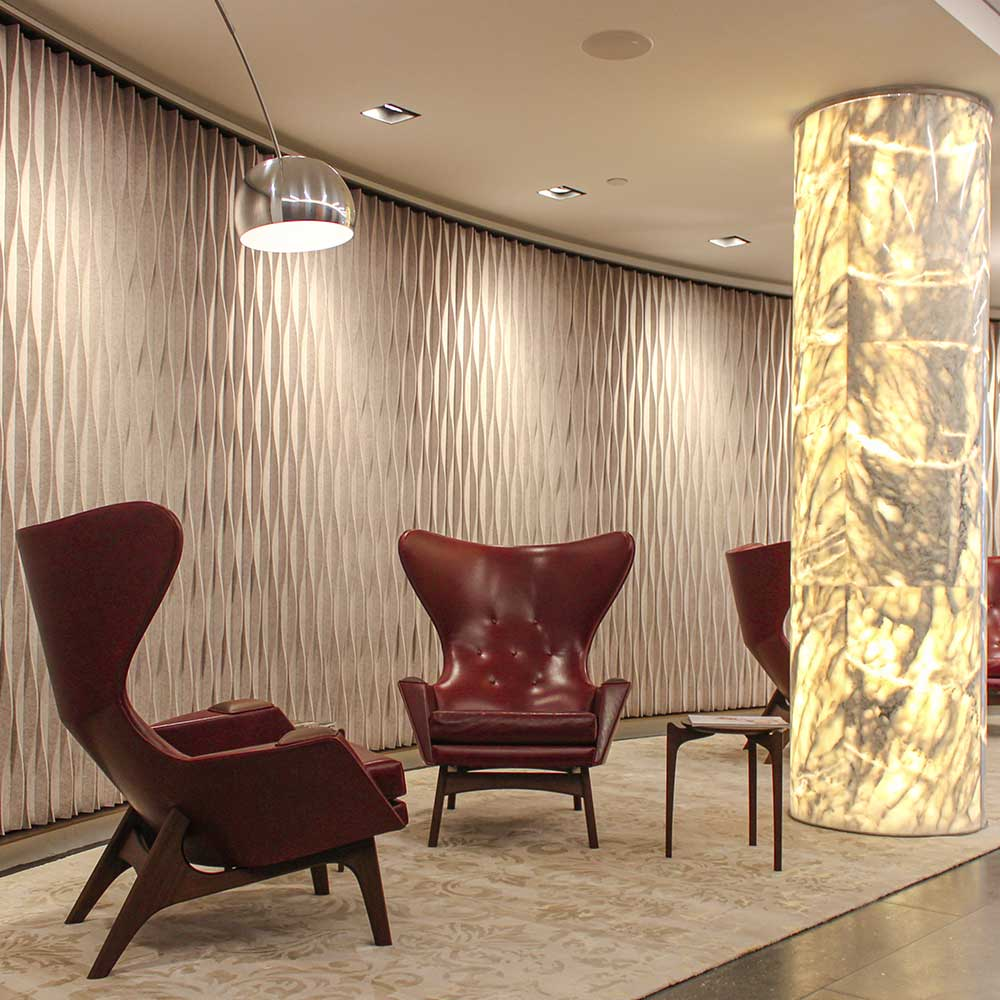 Corporate-reception-waiting-area-with-stylish-chairs-and-textured-walls after refurbishment
