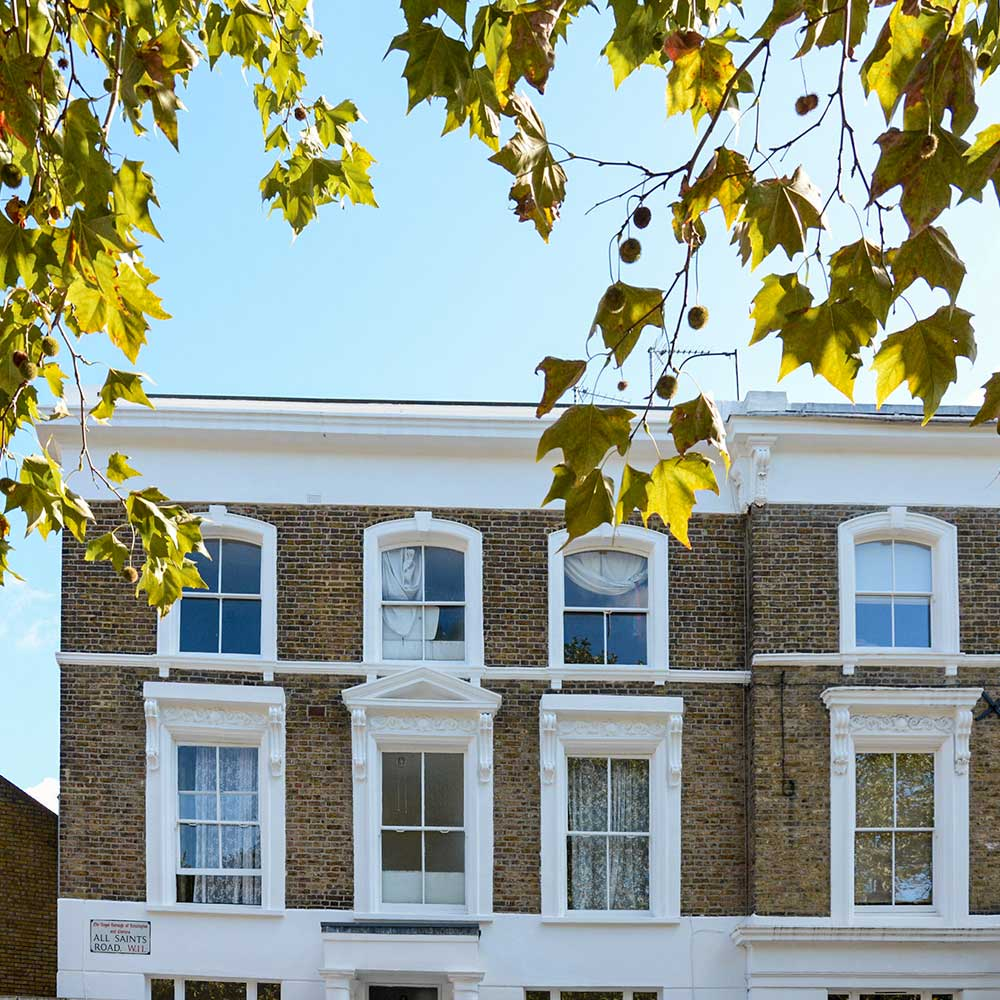 Exterior-shot-of-a-house-in the sun with wide shutter windows part of axis repairs in Hammersmith and Fulham