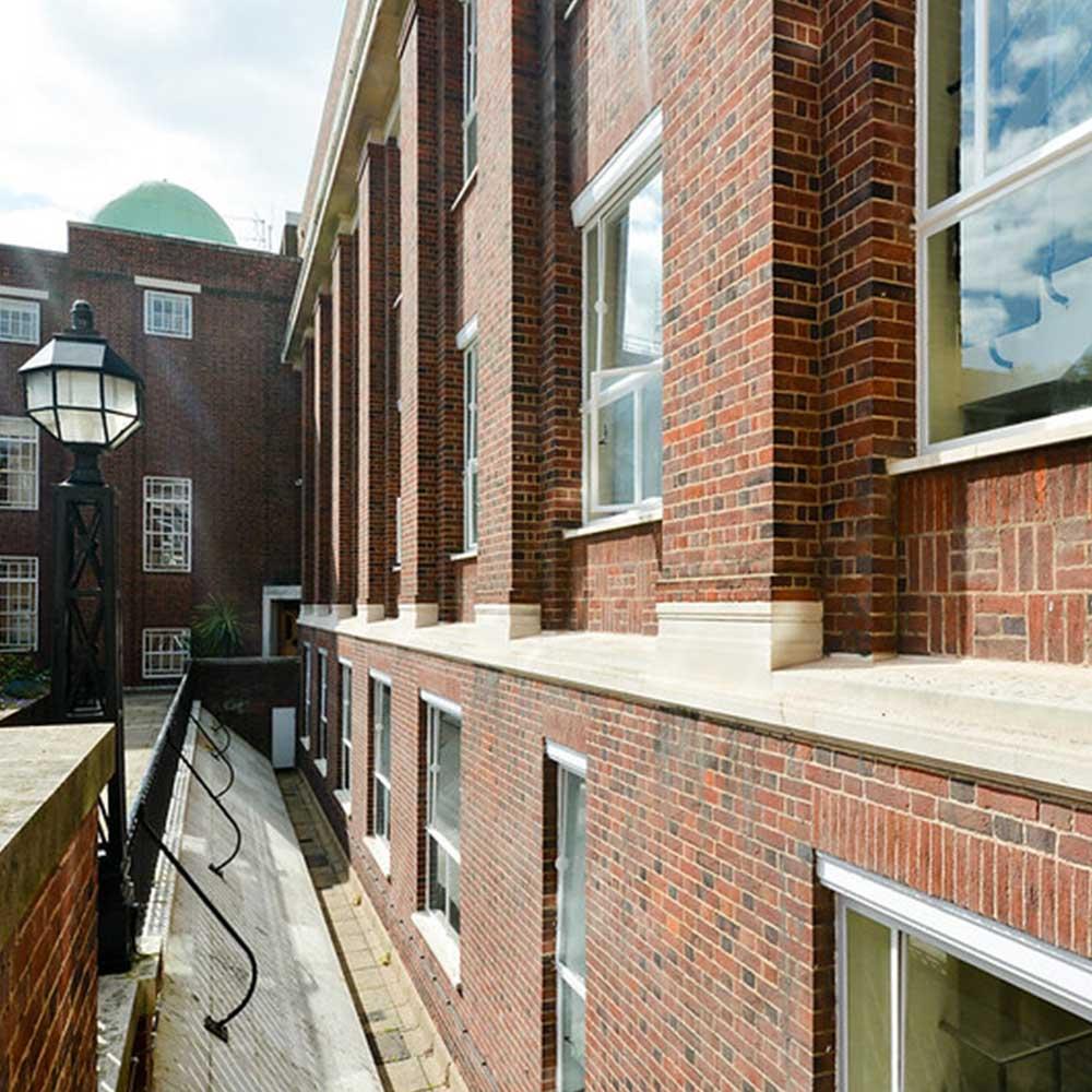 brickwork and windows on the renovated façade of regents university