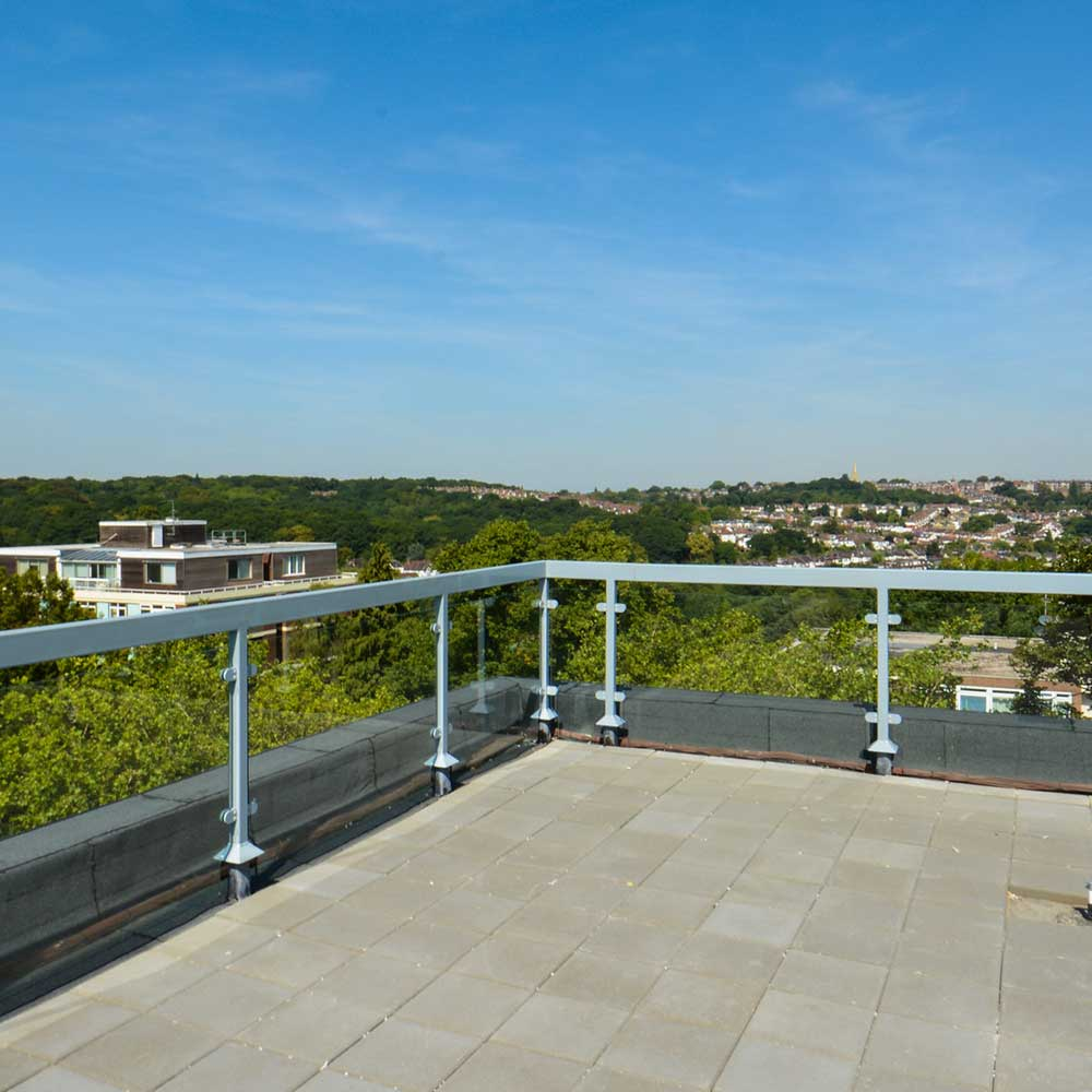 Guardian-Surveyors-roof-repaired and maintained-with-a-painted-rail and new tiles