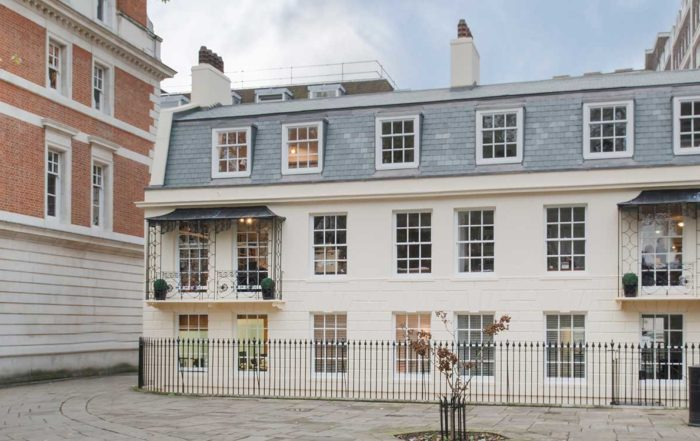 Beautiful heritage property with large windows and a blue slated roof repaired and refurbished by axis Europe.