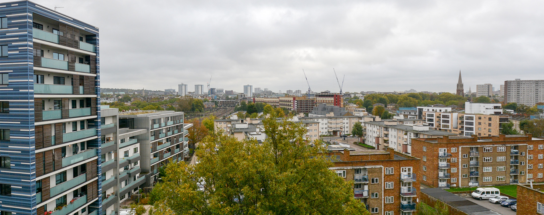 Wide shot showing many social housing void properties maintained by axis
