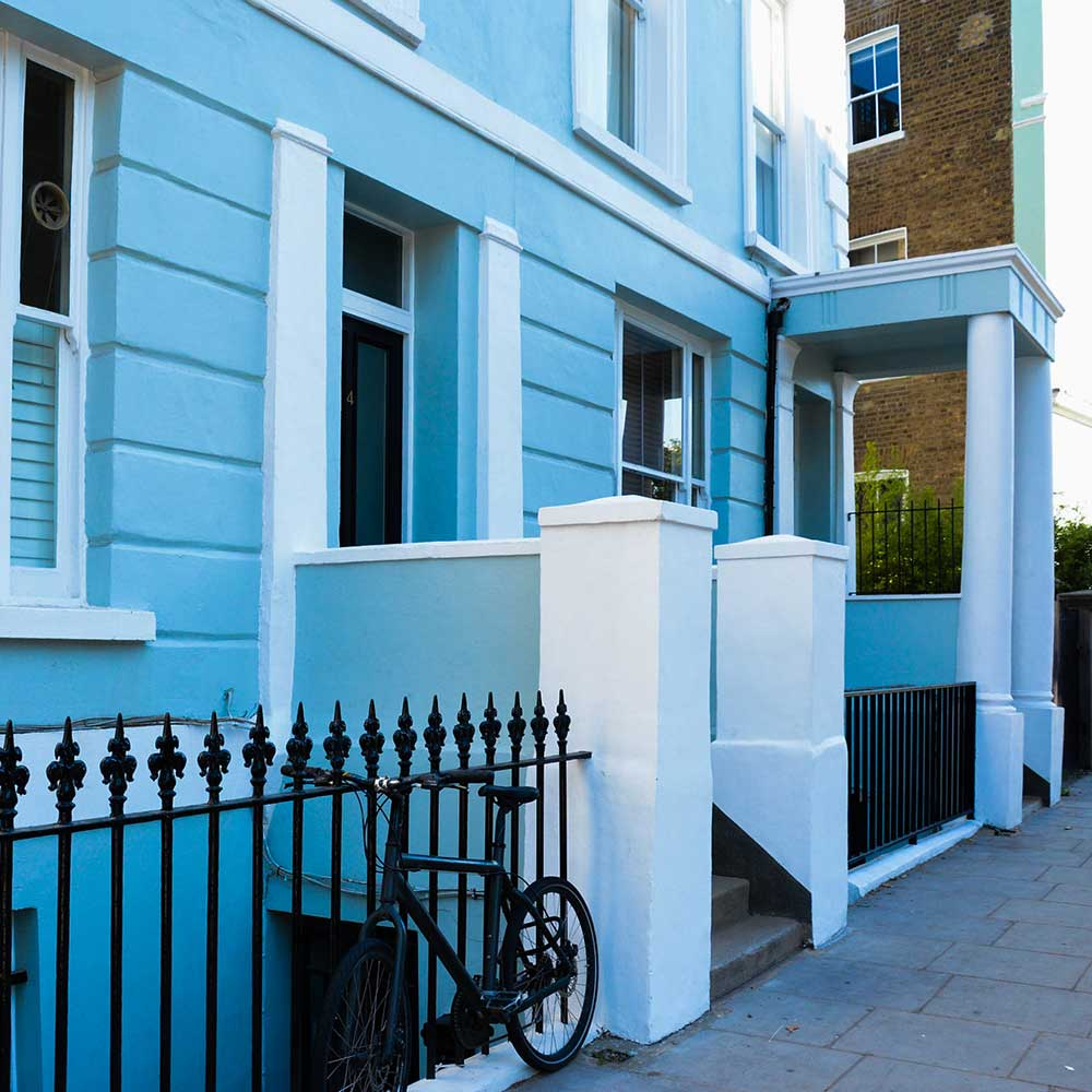 blue painted home-in-notting-hill-with-bike-on-painted-rails