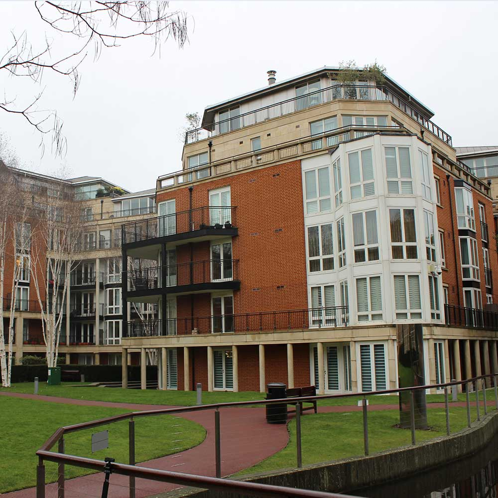 Garden area and several flats on a rainy day in Chelsea