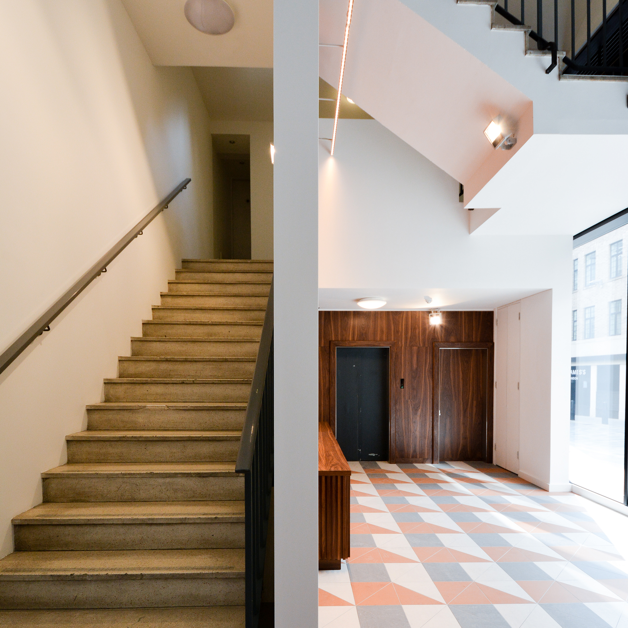 multiple internal staircases inside a corporate office space reception that has undergone refurb works