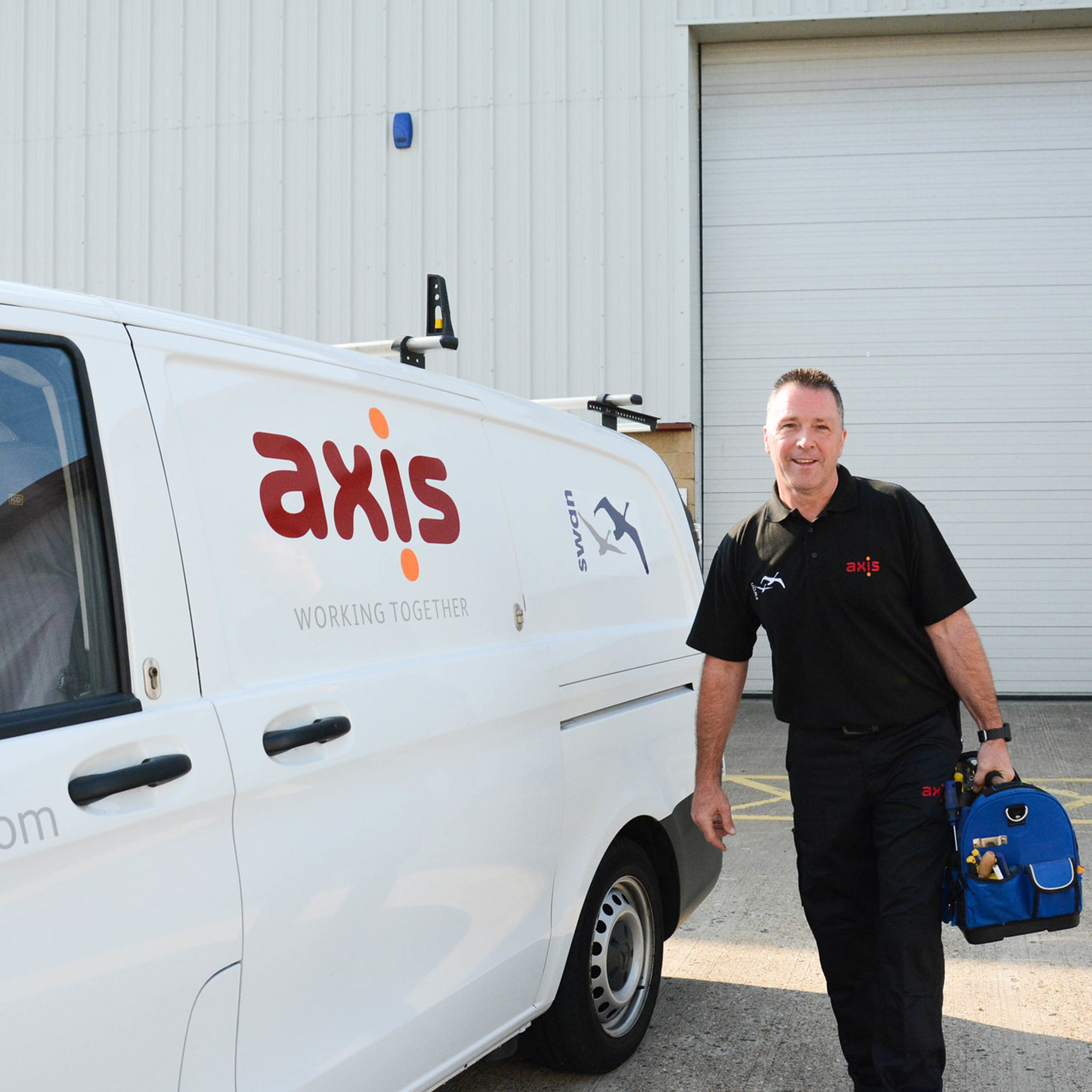 Axis and Swan operative standing beside a van