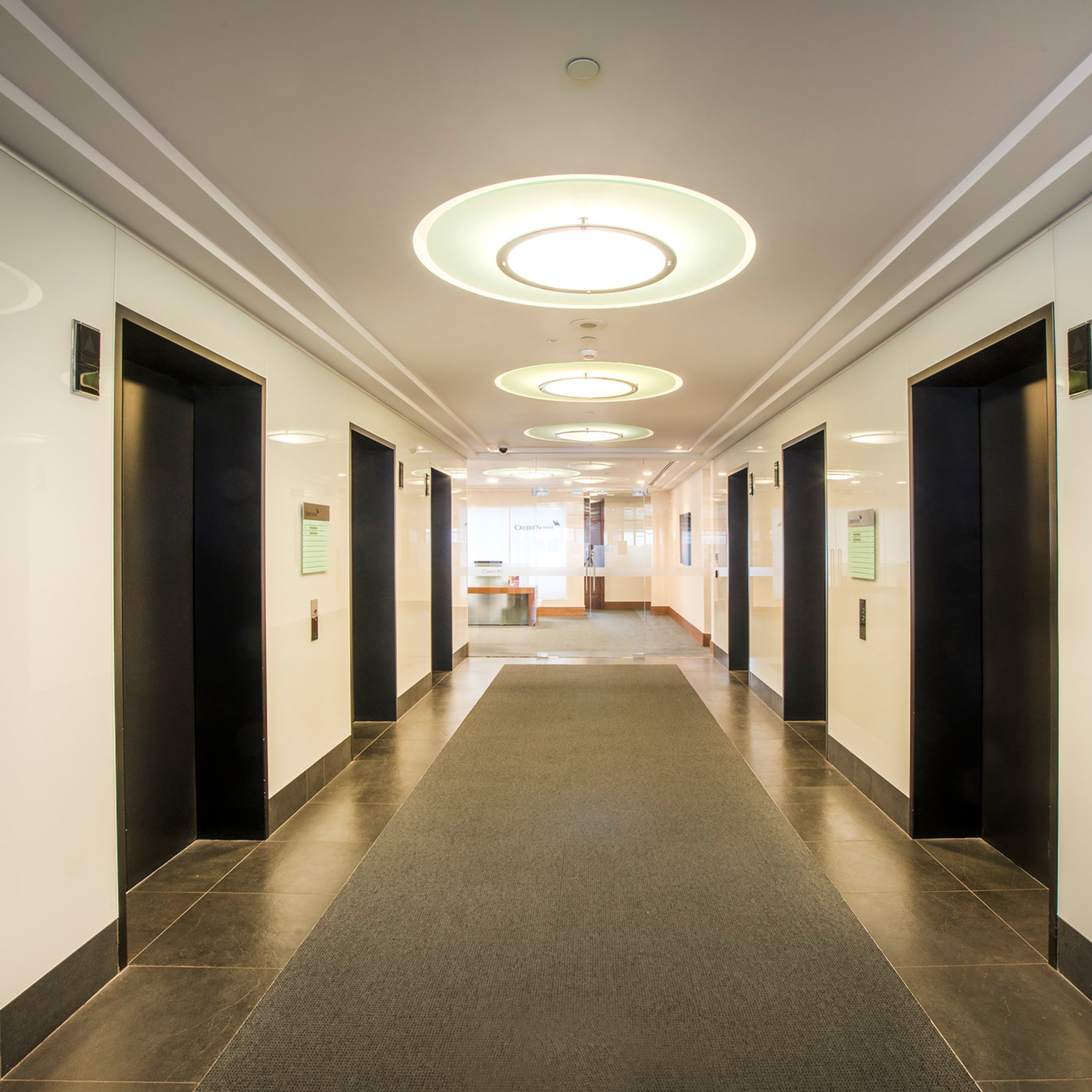 Large lights above a corridor in a refurbished and upgraded lobby