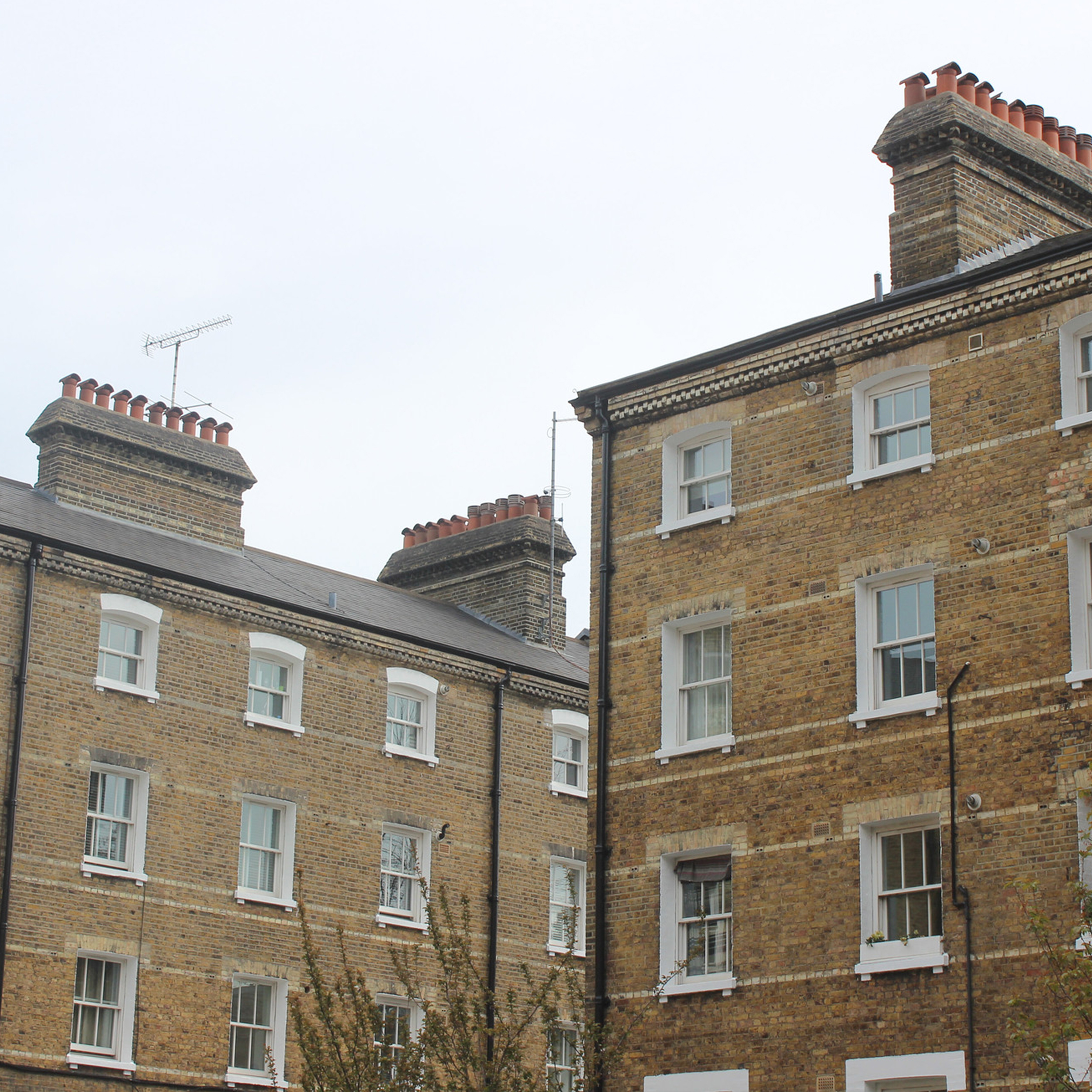two heritage grade two listed buildings with doff cleaned stonework