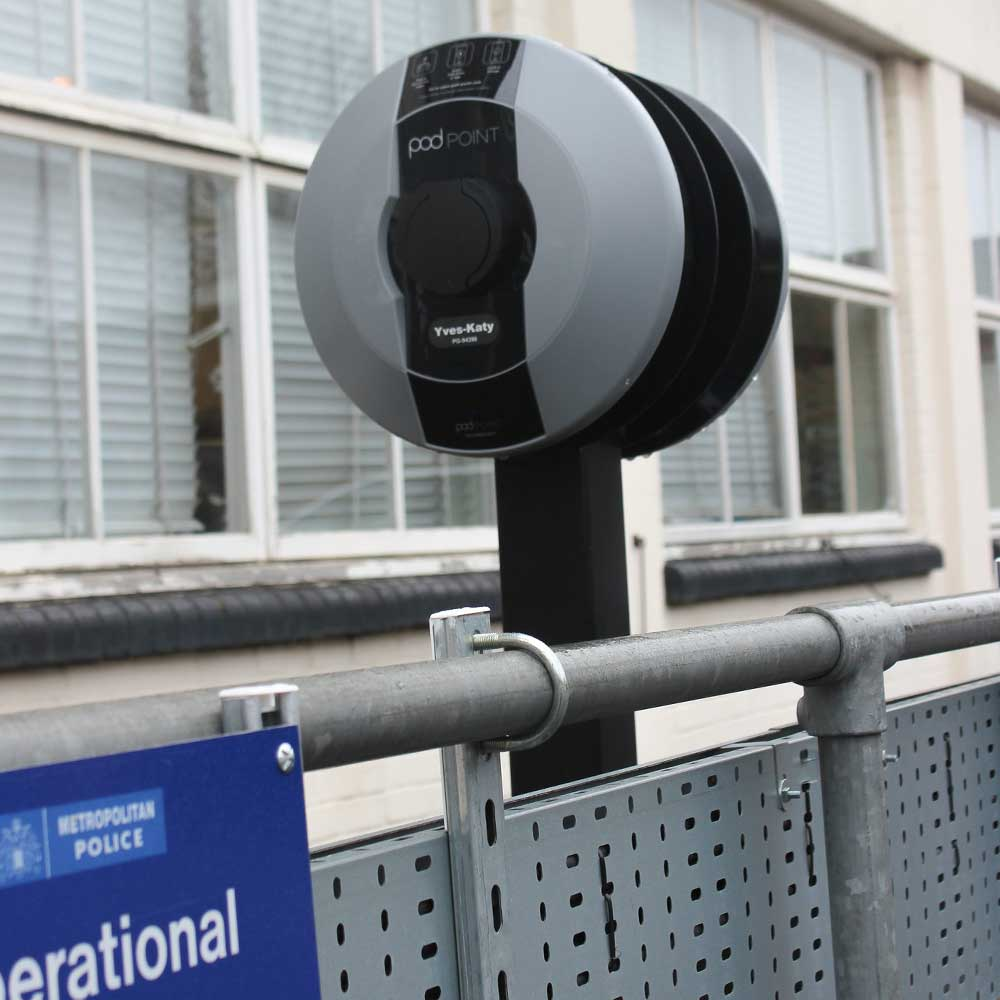 Met-police-charging-port-on-a-metal-rail in a police station