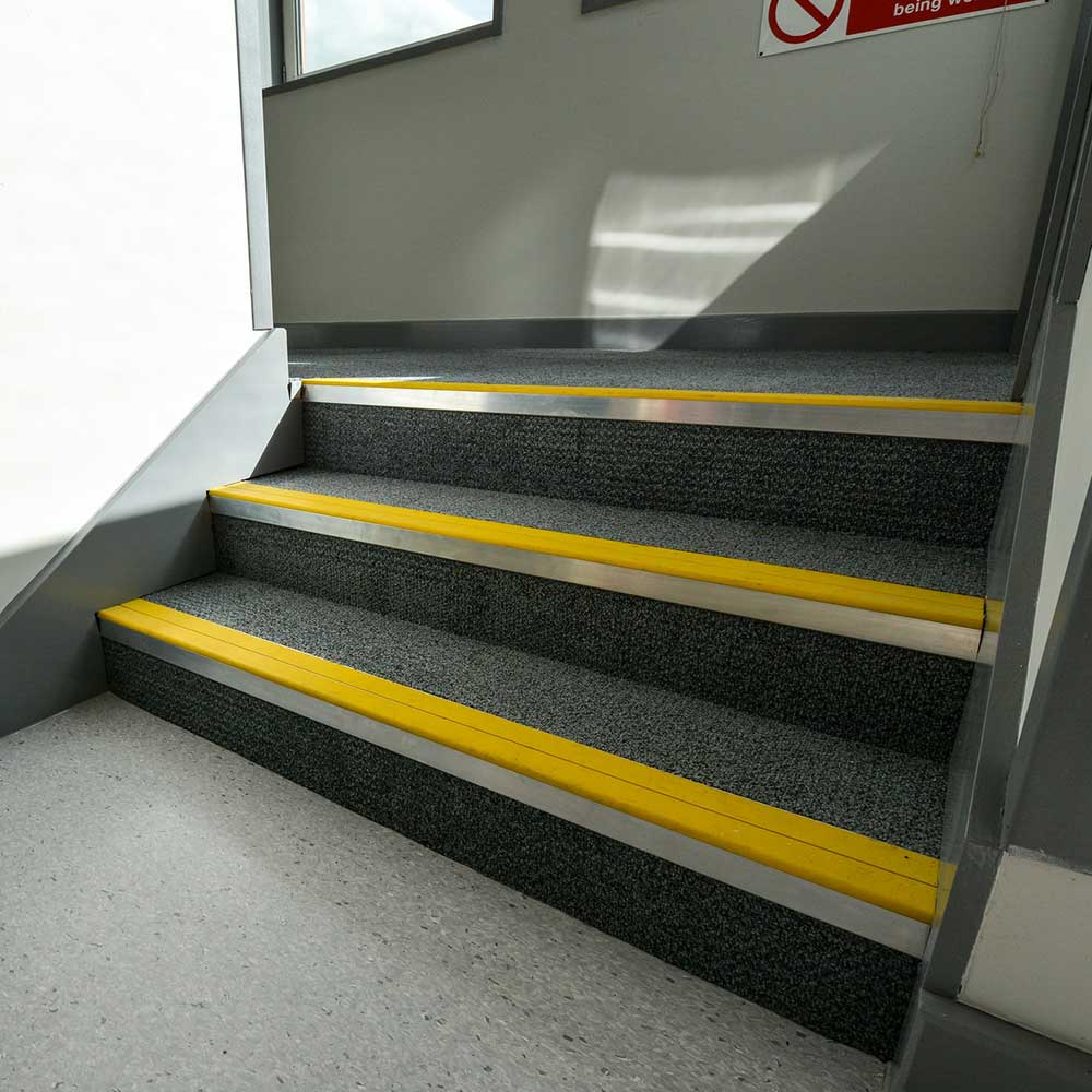 Small set of stairs with new carpets and step coverings part of axis works with the MET police