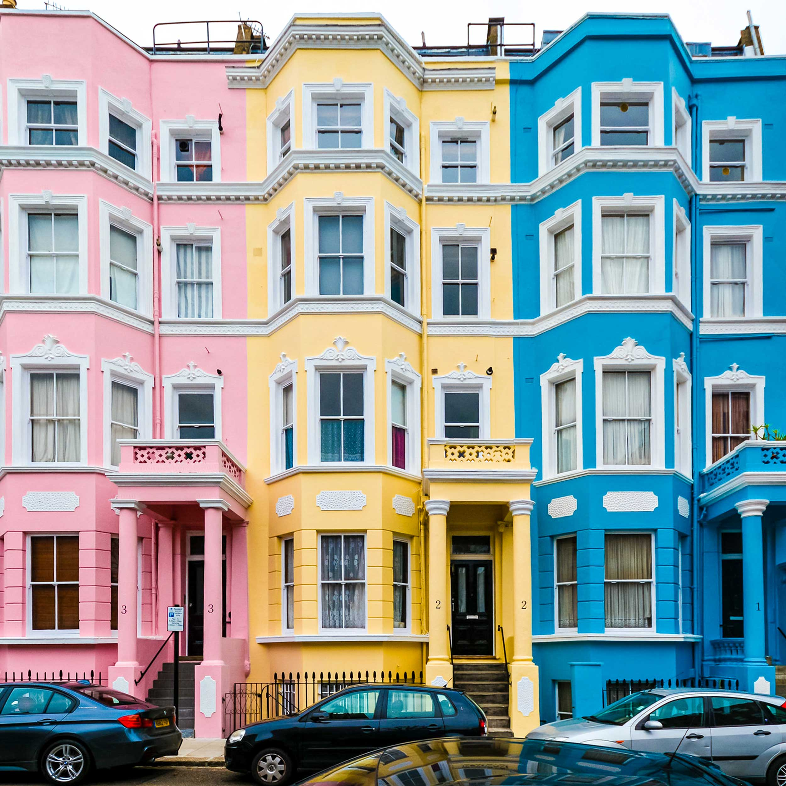 exterior housing painting projects in notting hill after repairs were carried out 3 colours pink, yellow and blue
