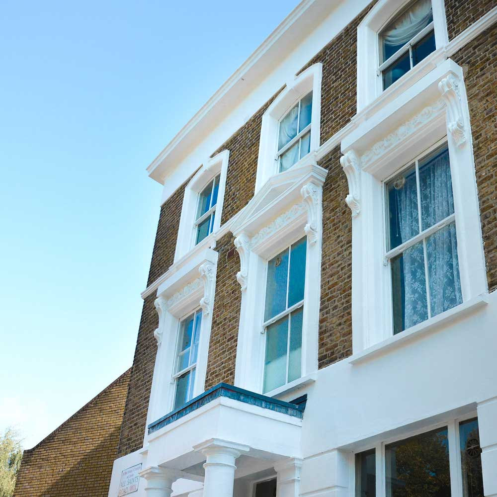 a beautiful home in notting hill with a blue sky part of axis cyclical works to paint and decorate the windows