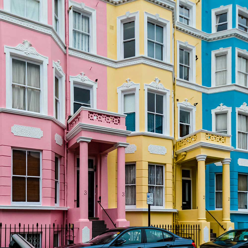Three painted and decorated houses in a line as part of the cyclical repairs carried out in Hammersmith and Fulham.