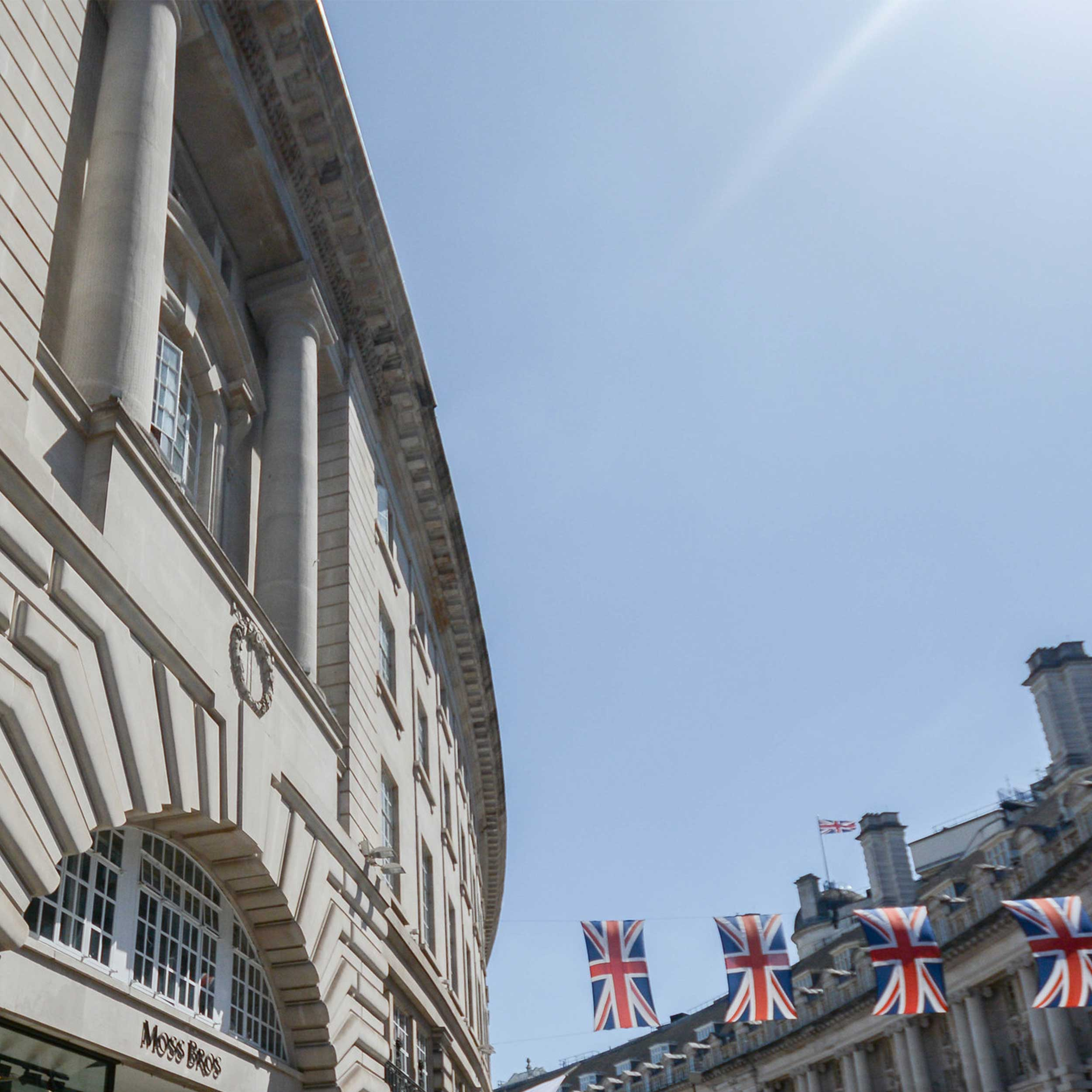 exterior of venture house office from regents street shows the british flag