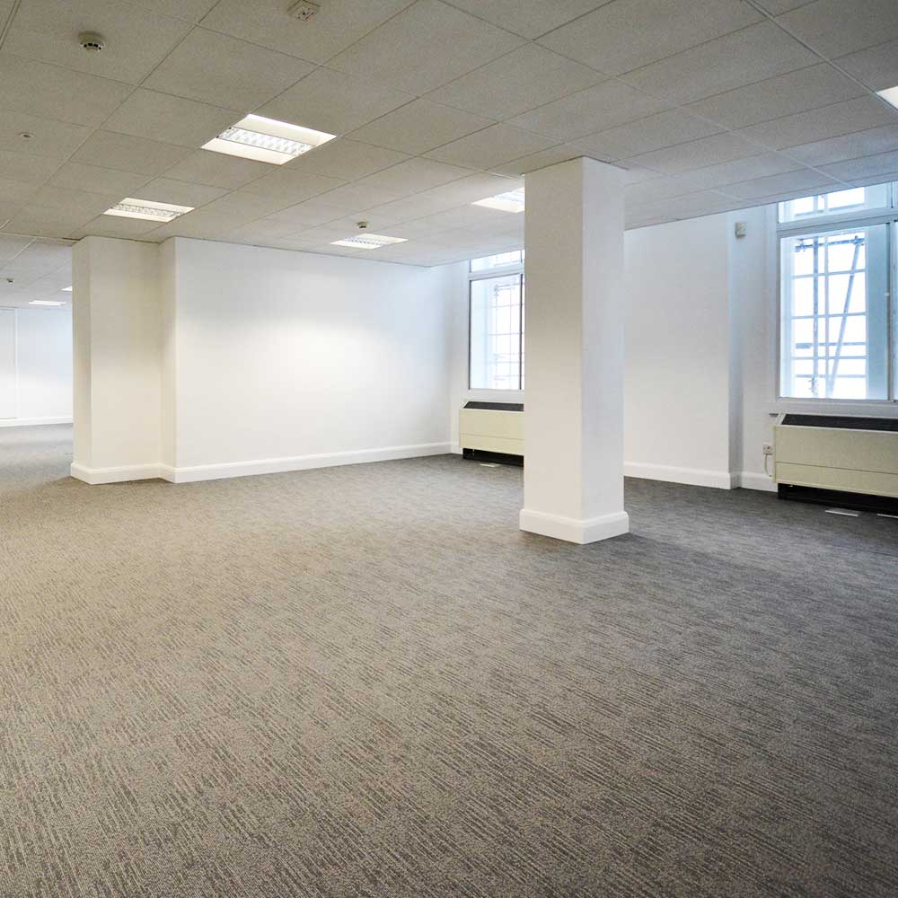 interior of the office showing windows carpets and refurbishment