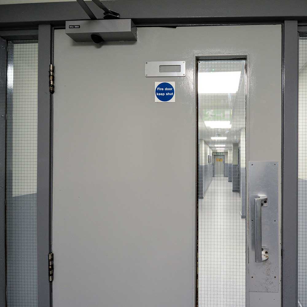 Fire door inside a police station in london door is part of the refurbishment works