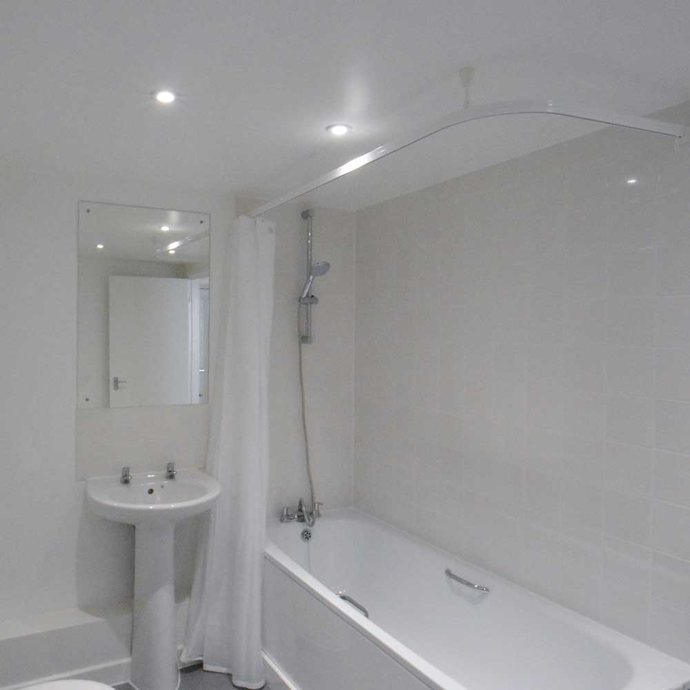 Bathroom conversion inside a residential property shows a sink and a bath