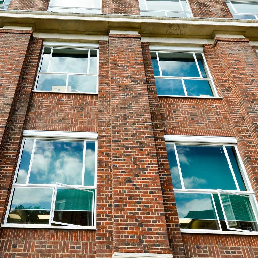 sky reflects off windows at regents university