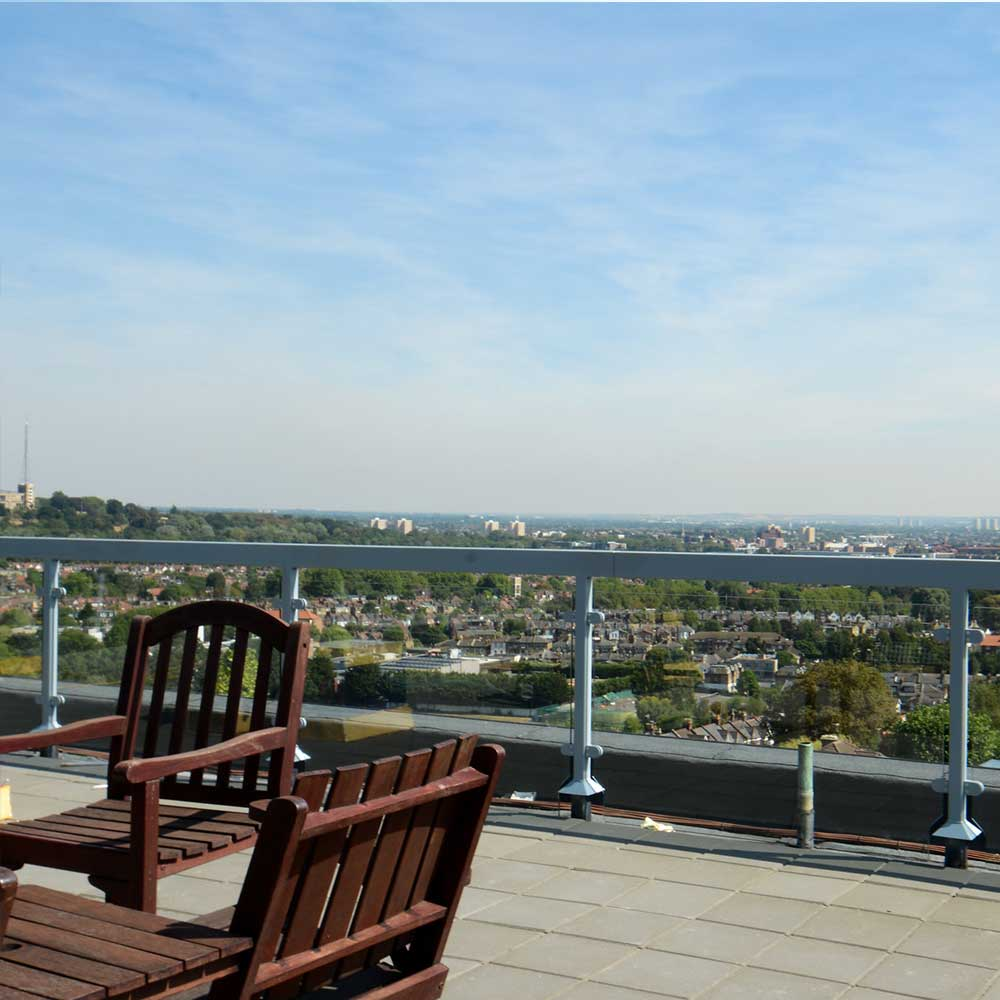 Rooftop maintenance including painting and decorating plus repair works to a large banister