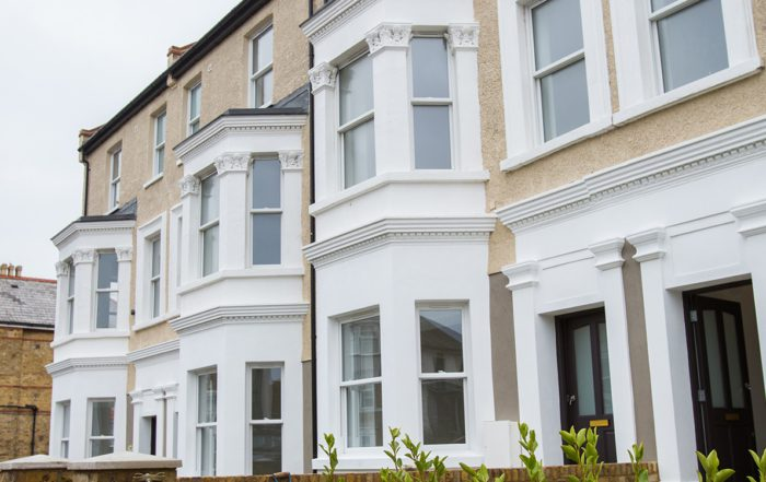 Convesrion project on derilict homes shows two or three terraces houses looking bright, fresh and new