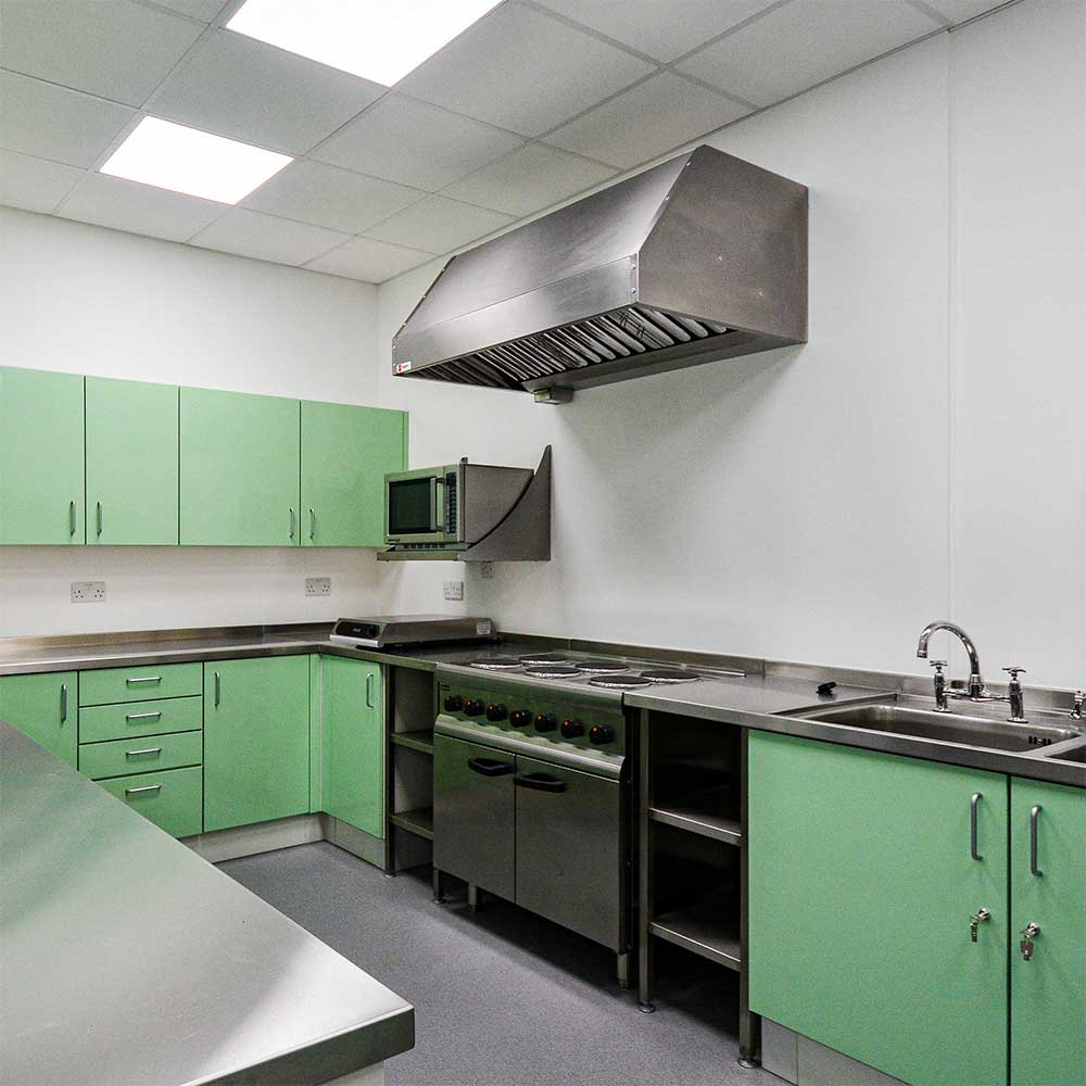 Silchester-hub-commercial kitchen with lights on after axis installation