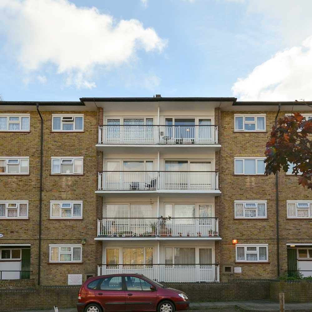 Balconys windows and brickwork on exterior of housing property