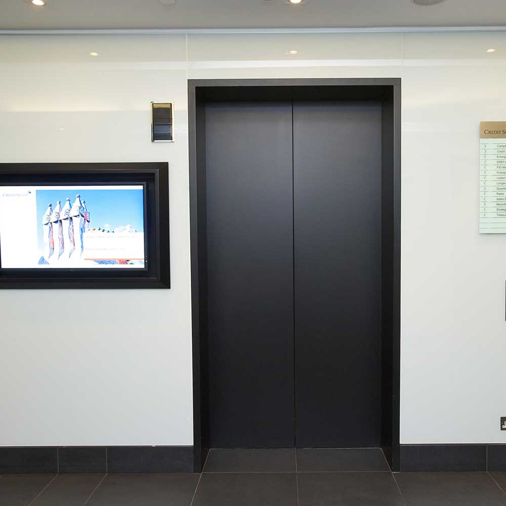 Lift with matte black finish after upgrade in a Lobby space