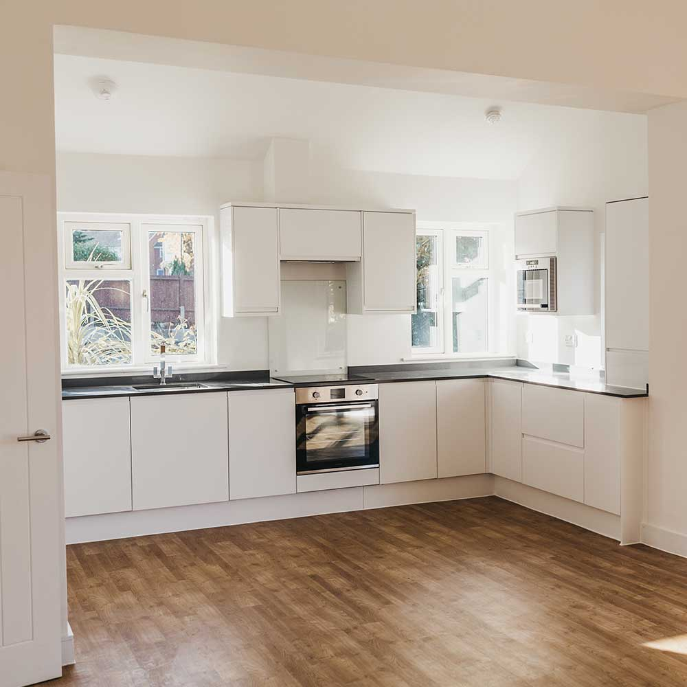 Large open plan kitchen in a flat that axis Europe refurbished