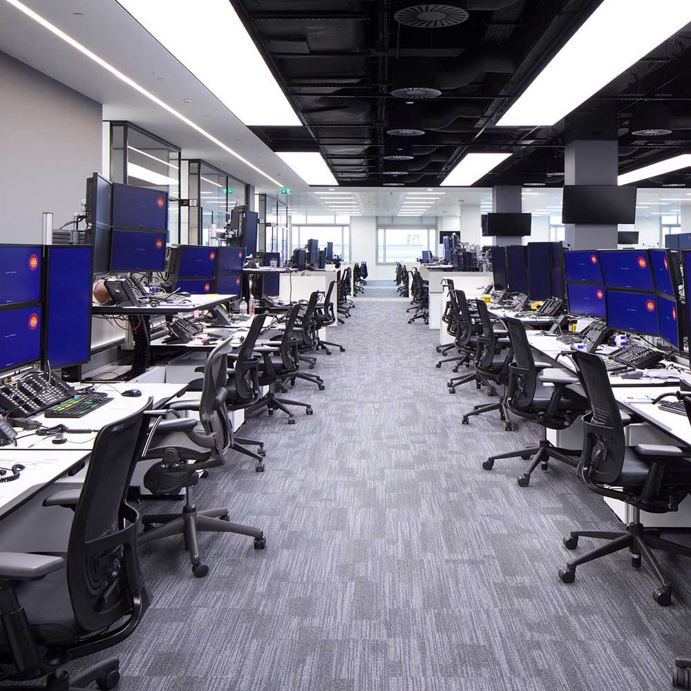 Large office space filled with chairs computers and phones. Shows the space before the data removal.