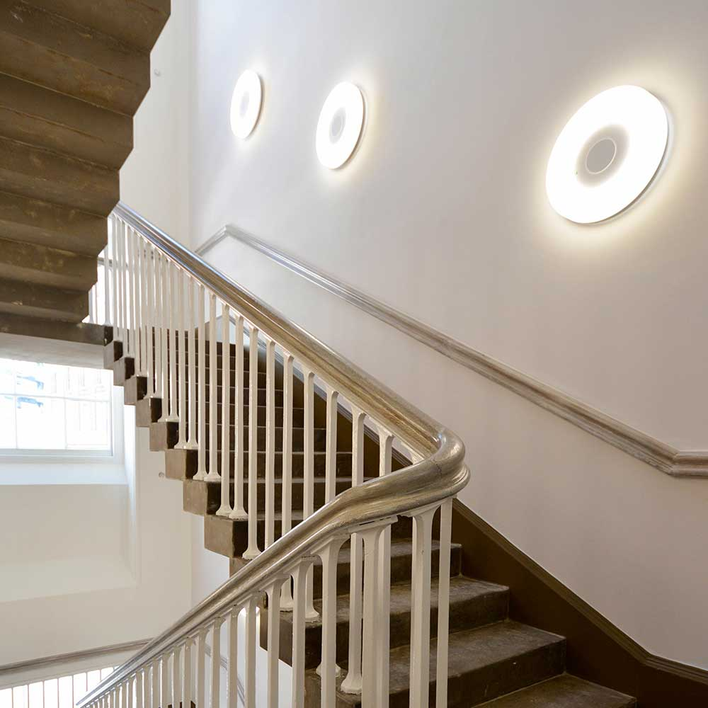 Staircase with bright lights and painted walls in a heritage building