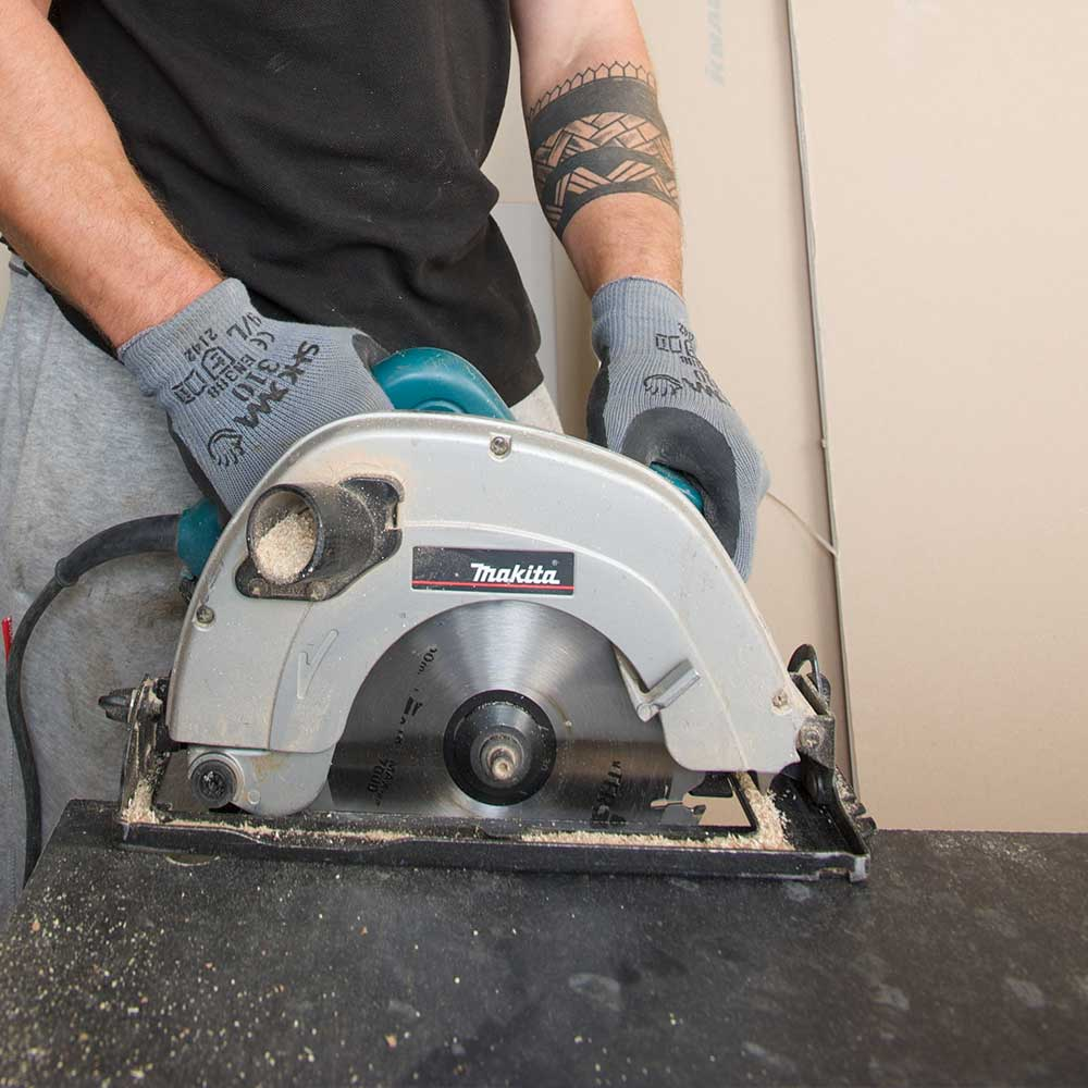 Axis operative sawing through a worksurface