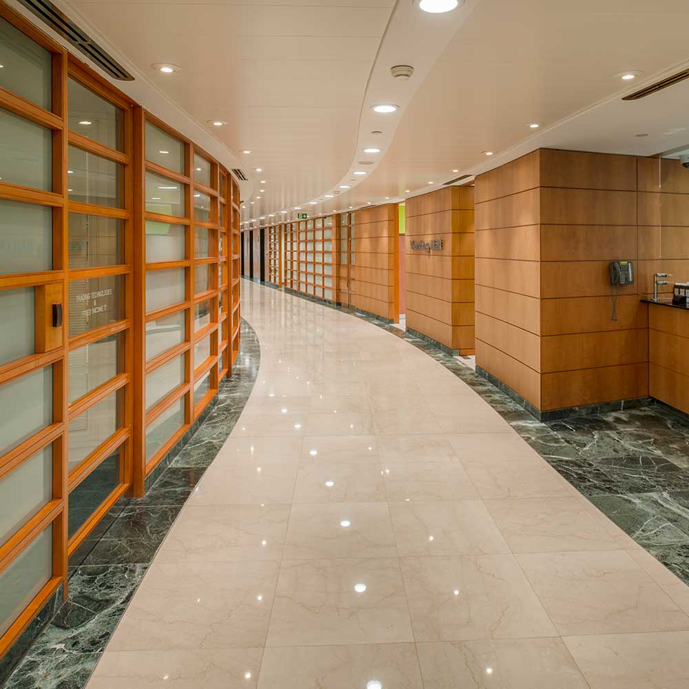 Huge open corridor with wooden panels and marble flooring upgraded by axis europe