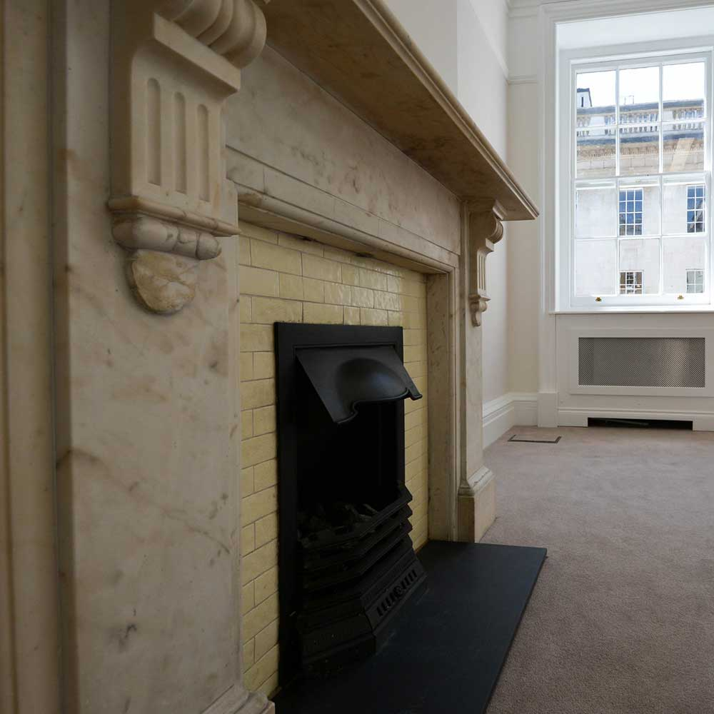 Old stonework fireplace in a renovated property