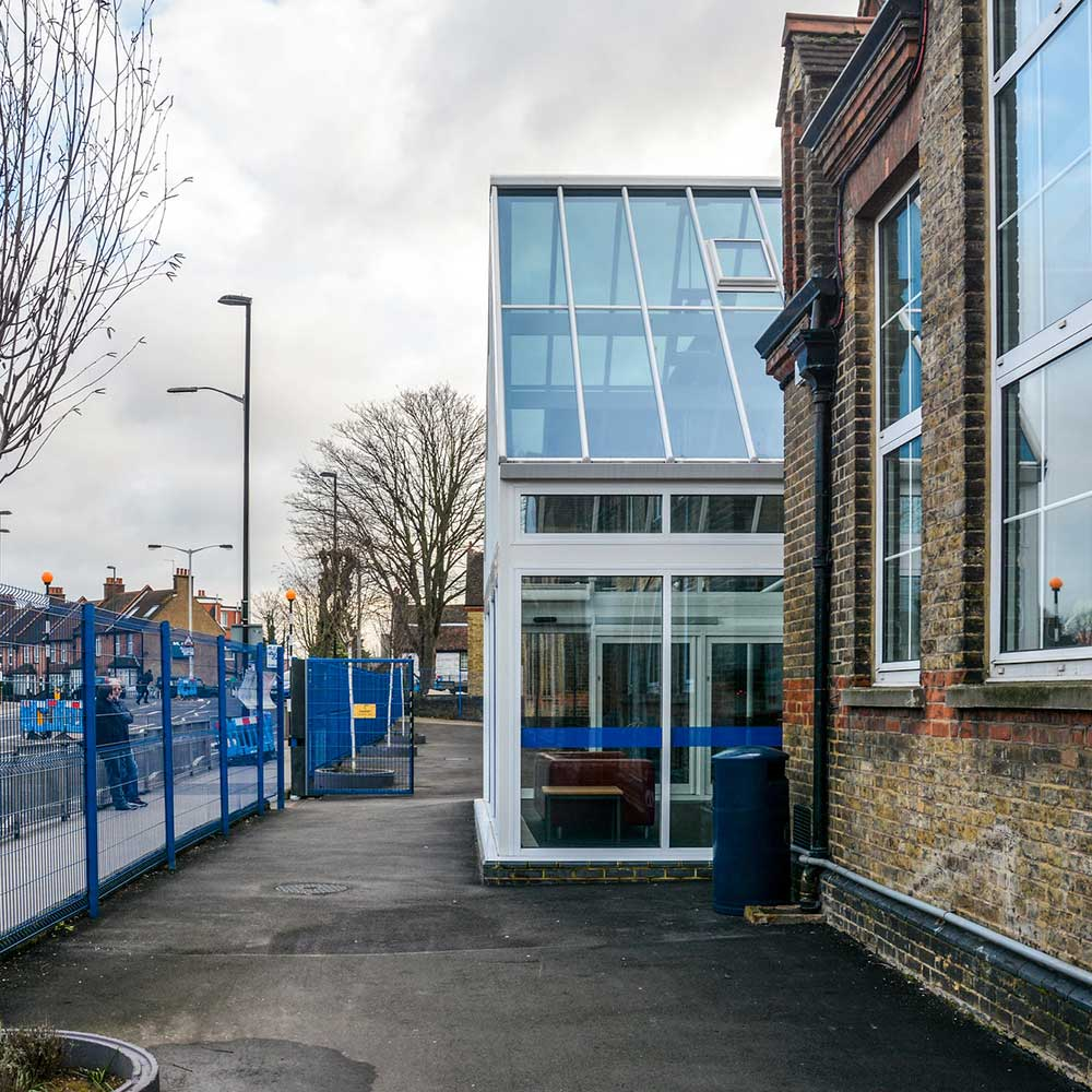 Exterior wall with windows and playground at a school with renovations and construction work undertaken