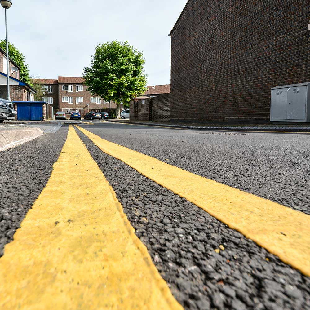 new painting works show yellow lines on a street in London