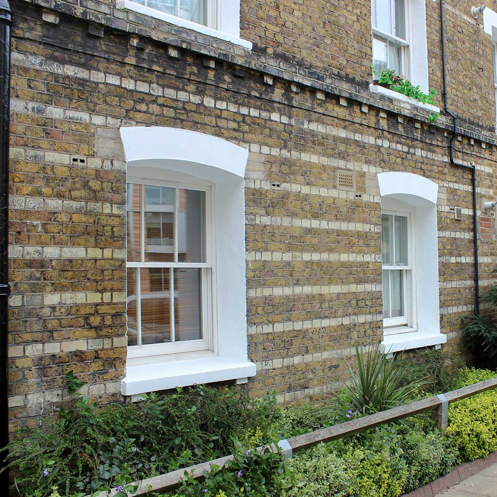 2 windows with fresh paint at an old heritage estate in south London refurbished by axis