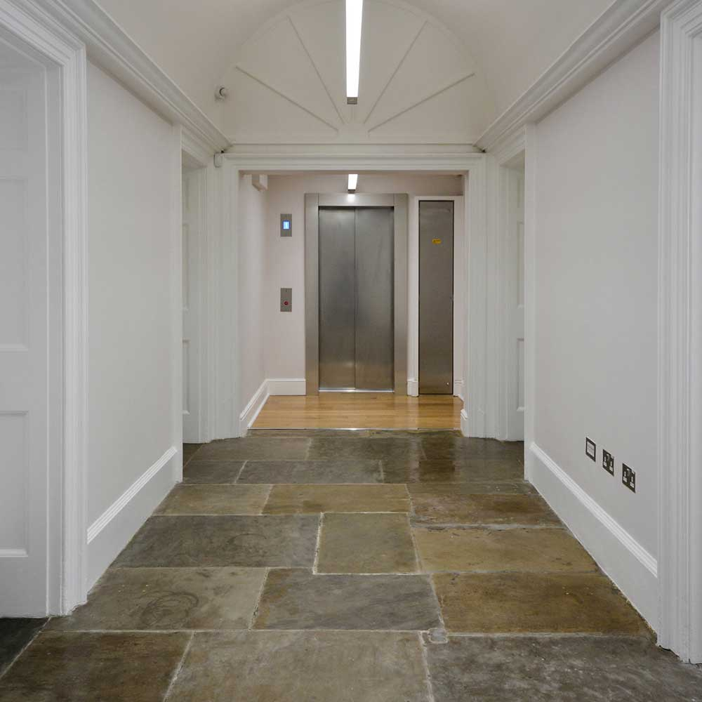 Corridor with stone flooring inside a heritage property undergoing renovation works