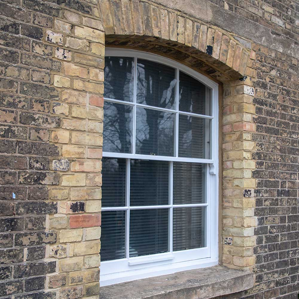 Window and stonework of a historic building repaired by Axis Europe