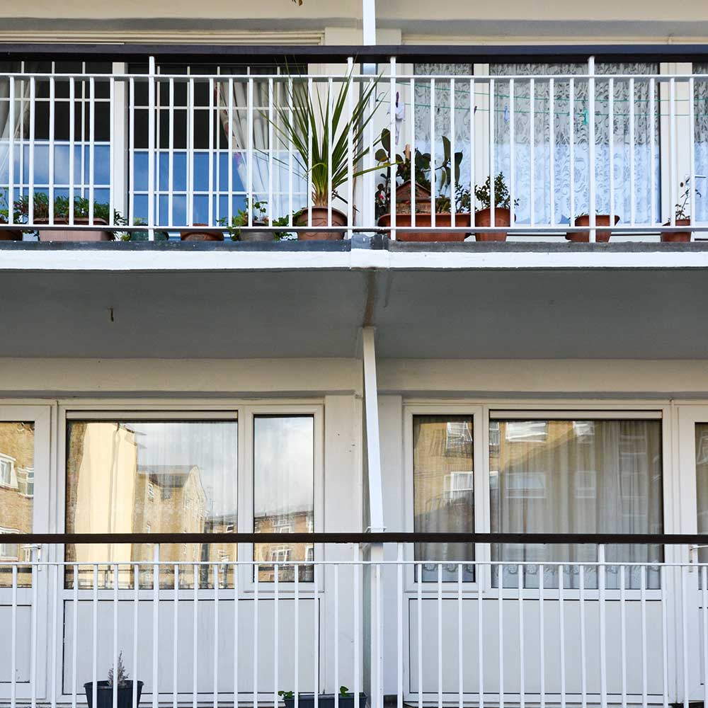 Cyclical repairs to housing property shows balcony's and windows