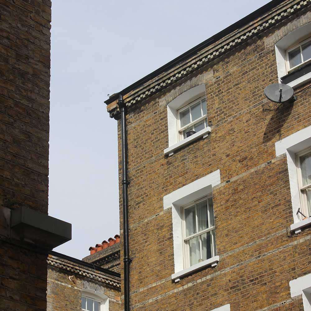 doff cleaning external repairs and redecorations carried out on the wall and windows shown