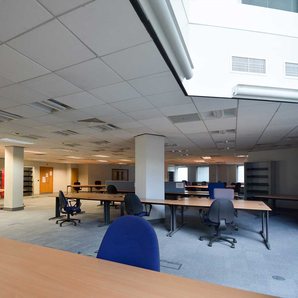 re stack project inside a met police station shows an open plan office space with chairss and desks