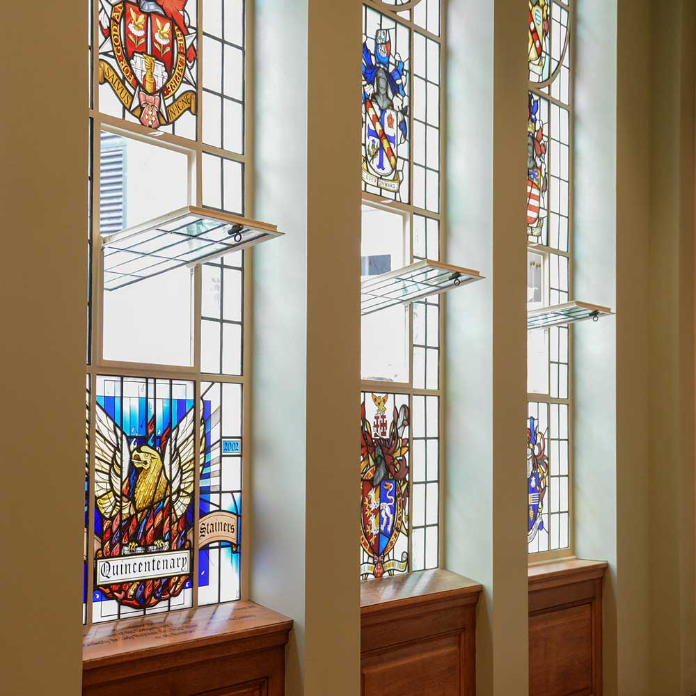 Stained-glass-panels-and-varnished-wood-detail-shots-in-painters-hall