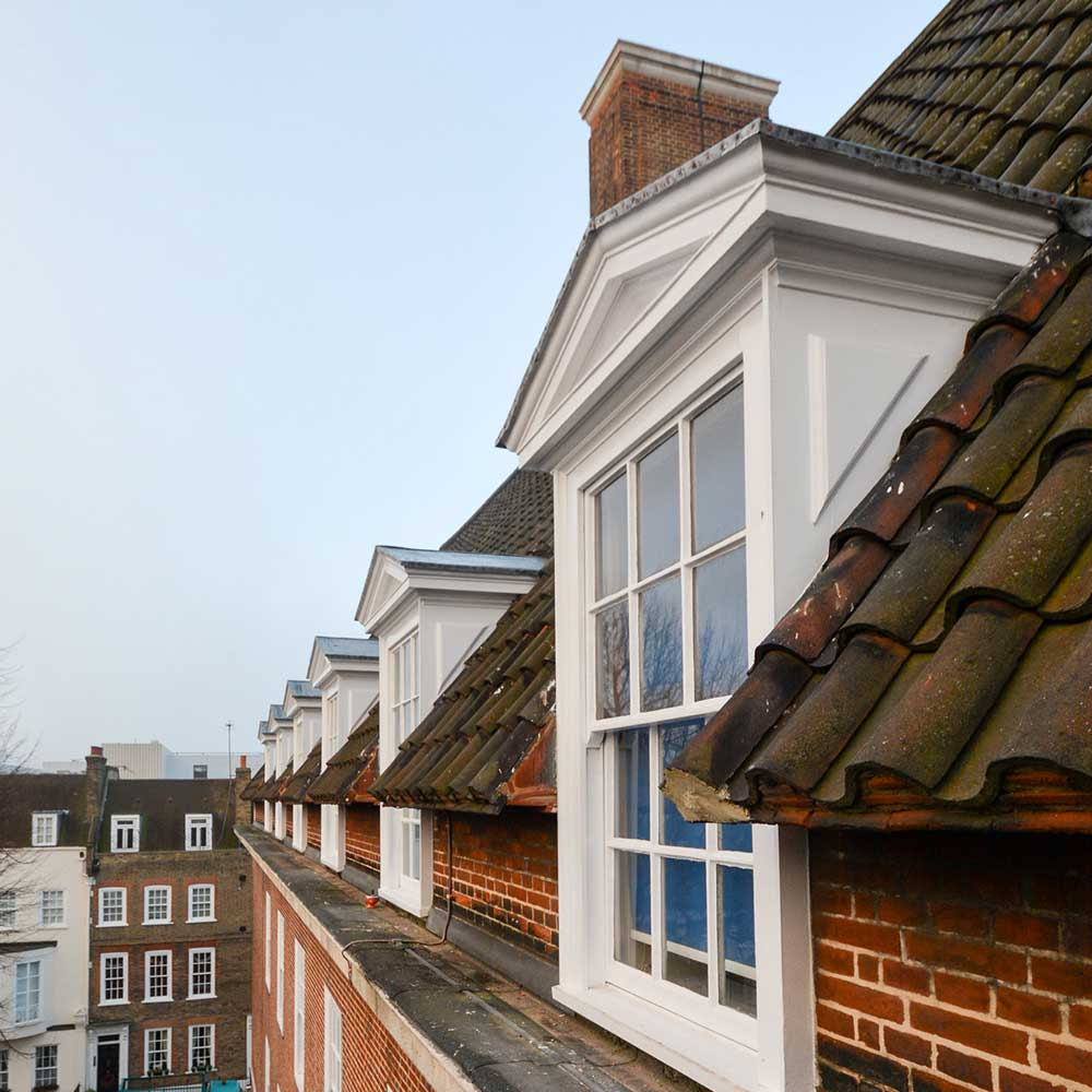 a rooftop window on a block in greenwich university that has painted windows as part of the refurbishment project