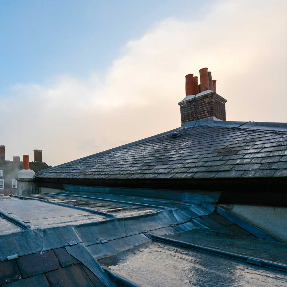 University-Refurbishment-leaded rooftop-on-a-moody-winter day