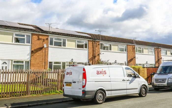 Axis Van on a street outside a property in wrexham that is serviced by axis