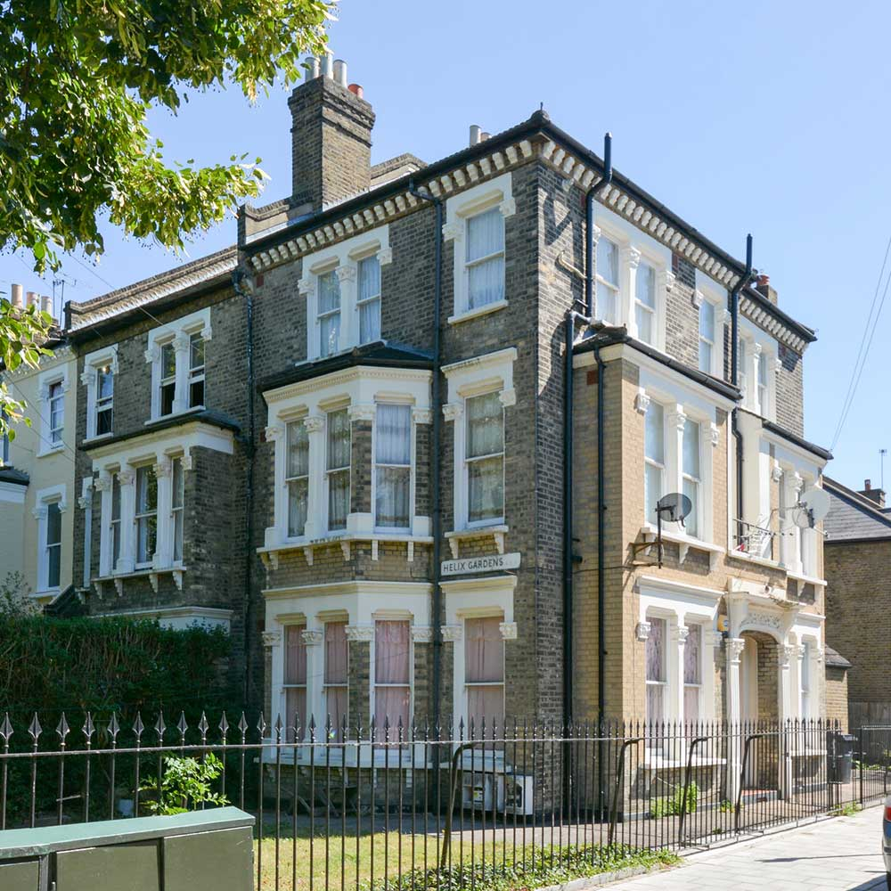 Large property in London with huge bay windows and a painted railing
